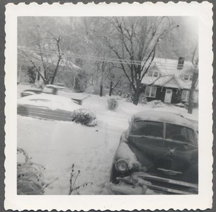 Photo of 1950 Chevy 1948 Hudson on Snowy Delmas Avenue in Nashville Tennessee dated 1951